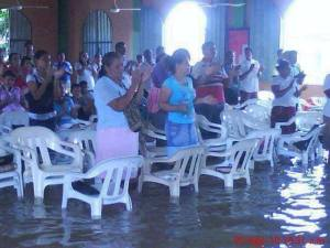 Philippine Christians gather to worship after a devastating typhoon in November 2013